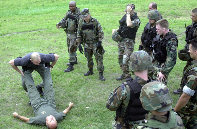 Sergeants Rob Erickson (holding legs) and Gary Wilkerson, of the Los Angeles Sheriffs Department, teach 35th Security Forces Squadron (SFS) troops from Misawa Air Base, Japan, how to carry an injured hostage. The Los Angeles Sheriffs Department's special enforcement bureau sent its special weapons and tactics, or SWAT, team to Misawa to train the 35th SFS' emergency services team (EST). Misawa's EST is a team of security force members specially trained to handle high risk situations