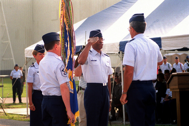81st Training Wing Change of Command. US Air Force Brigadier General Roosevelt Mercer Jr. (2nd from right), new Commander, 81st TRW, Keesler Air Force Base, Mississippi, salutes before receiving the guidon from USAF CHIEF MASTER Sergeant McCann while USAF BGEN Elizabeth Ann Harrell (Left), outgoing Commander, 81st TRW, and USAF Major General John F. Regni, Commander, 2nd Air Force, Keesler AFB, MS, looks on