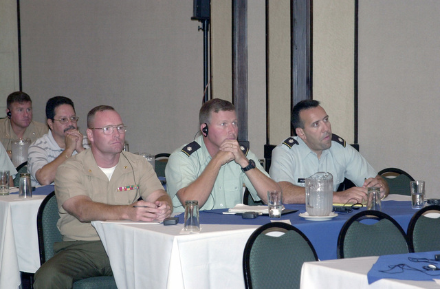 Members of the United States Southern Command (SOUTHCOM) J34 attend the March 2001 Fuerzas Aliadas Humanitarias (Allied Forces Humanitarian) Conference held at the Hotel Melia Corobici in San Jose, Costa Rica. Front row left-to-right are US Marine Corps Major (MAJ) Dale Johnson; US Army (USA) Lieutenant Colonel (LTC) Joseph Cormack and USA LTC Robert Valdivia