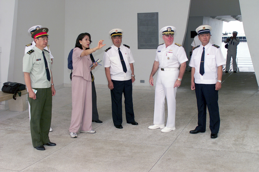 US Navy (USN) Read Admiral (RADM) Robert T. Conway Jr. (second from right), Commander, USN Region Hawaii and Chinese People's Liberation Army (Navy) Officers, are given a tour aboard the USS ARIZONA (BB 39) Memorial, at Pearl Harbor, Hawaii