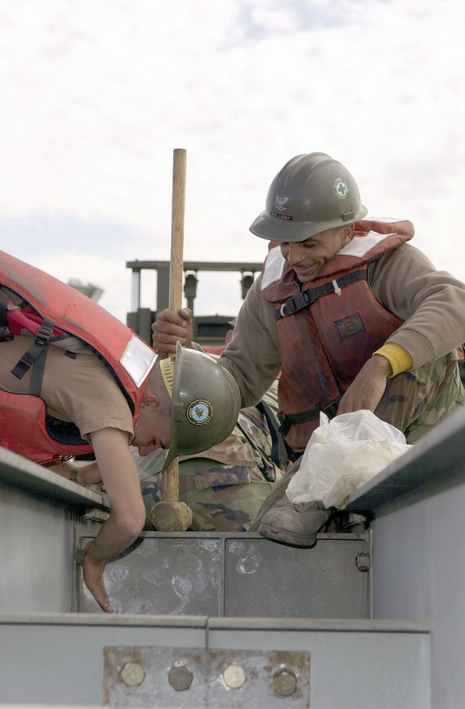 US Navy (USN) Equipment Operators (EO), Shawn Lebby and Jason Felix, both assigned to Amphibious Construction Battalion (ACB-1), Naval Amphibious Base Coronado, California (CA), assemble a turntable for a causeway built during Exercise TURBO PATRIOT, a Joint Logistics Over-the-Shore (JLOTS) Exercise, at Camp Pendleton, California (CA)