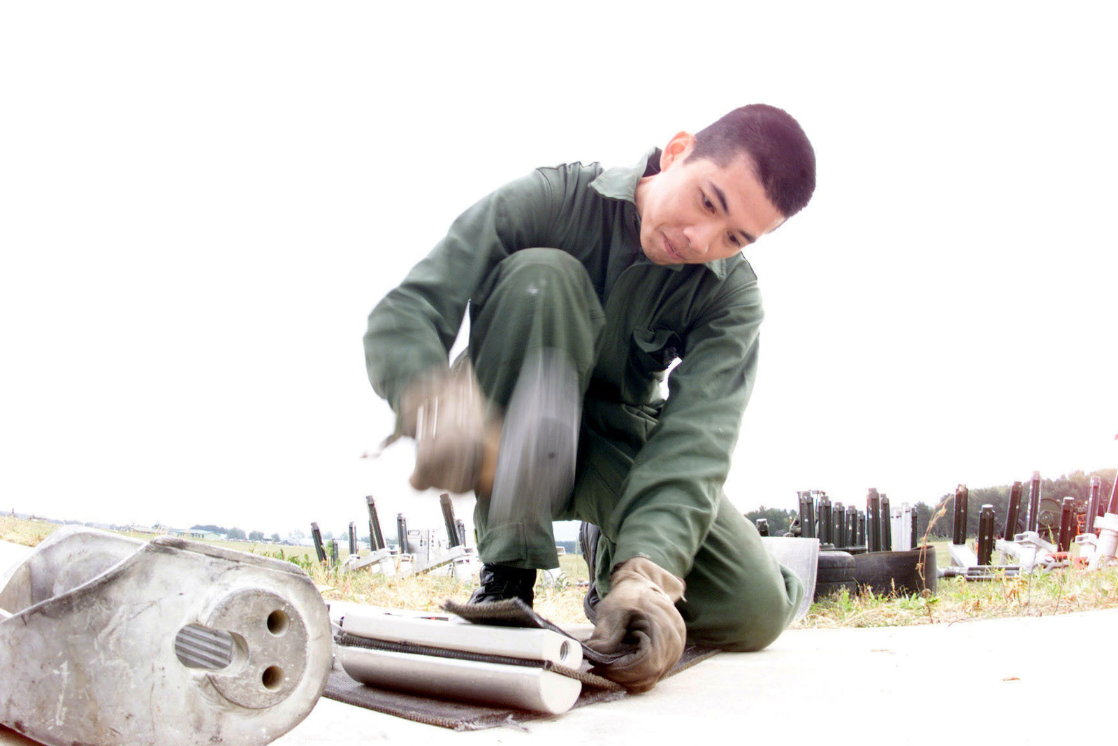 AIRMAN First Class Vincent Tu, an Electrical Power Maintainer from the United States Air Forces in Europe Construction Training Squadron, Ramstein Air Force Base, Germany, attaches a tape connector to a Mobile Aircraft Arresting System at Kuchyna Air Base, Slovakia