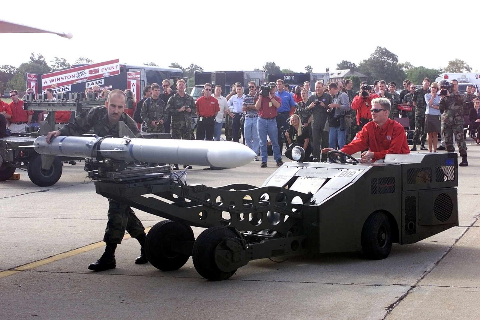NASCAR Driver And 1999 Busch Series Champion Dale Earnhardt Jr Carefully Lines Up An AIM 120missile During A Load Crew Competition At Langley Air Force