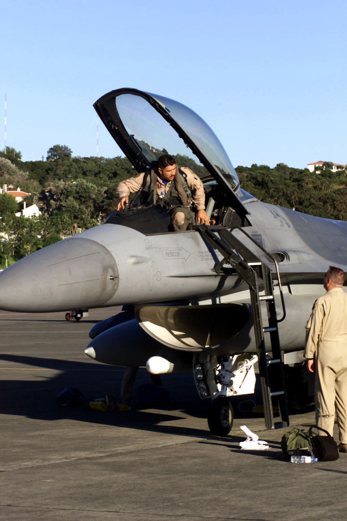 US Air Force Captain Tony Meyer prepares to exit his F-16 Fighting Falcon aircraft after landing at Lajes Air Base, Azores. His unit, the 55th Expeditionary Fighter Squadron, Shaw Air Force Base, South Carolina, returned from Incirlik Air Base, Turkey, in support of Operation NORTHERN WATCH