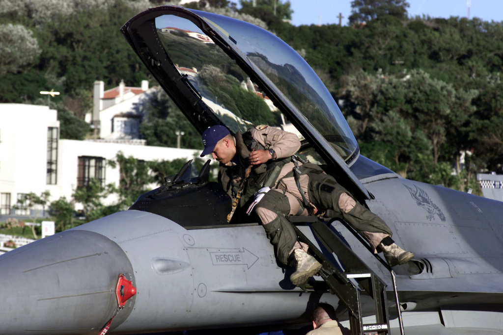 US Air Force Captain Tony Meyer prepares to leave his F-16 Fighting Falcon aircraft after landing at Lajes Air Base, Azores. His unit, the 55th Expeditionary Fighter Squadron, Shaw Air Force Base, South Carolina, stopped over on a return leg from Incirlik Air Base, Turkey, in support of Operation NORTHERN WATCH