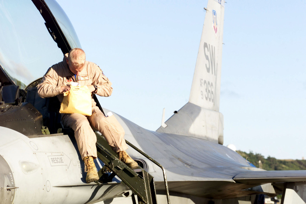 US Air Force Captain Vincent Cyran prepares to exit his F-16CJ aircraft upon landing at Lajes Air Base, Azores. His unit, the 55th Expeditionary Fighter Squadron, from Shaw Air Force Base, South Carolina, is on a return leg from from Incirlik Air Base, Turkey, in support of Operation NORTHERN WATCH