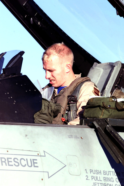 US Air Force Captain Vincent Cyran prepares to exit his F-16CJ aircraft upon landing at Lajes Air Base, Azores. His unit, the 55th Expeditionary Fighter Squadron, Shaw Air Force Base, South Carolina, is on a return leg from Incirlik Air Base, Turkey, in support of Operation NORTHERN WATCH