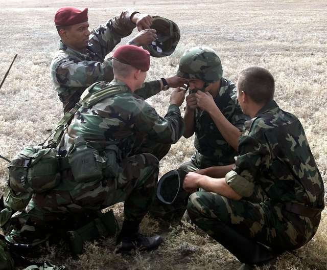 United States Army 82nd Airborne Division paratroopers give their Kazakhstan counterparts a feel for US protective equipment during an international mass jump into Kazakhstan. Paratroopers from Kazakhstan, the United States and Turkey are descending into Kazakhstan to prepare for the the start of Central Asian Peacekeeping Battallion (CENTRASBAT) 2000. The CENTRASBAT 2000 exercise is a multi-national, in the Spirit of Partnership for Peace, peacekeeping and humanitarian relief exercise sponsored by US Central Command (US CENTCOM) and hosted by the former Soviet Republic Kazakhstan in Central Asia, 11-20 September 2000. Exercise participants include approximately 300 US troops including ...