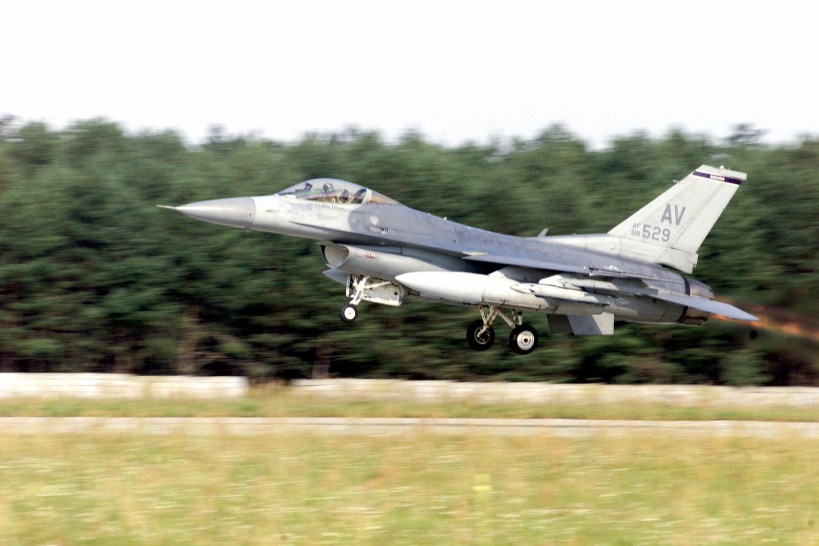 A United States Air Force F-16C Fighting Falcon, 510th Fighter Squadron, 31st Fighter Wing, deployed from Aviano Air Base, Italy, lifts-off as it heads to the range for the day's first sortie. Training Exercise Iron Claw, Kuchyna AB, Slovakia, 11 September 2000
