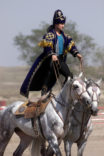 A Kazakh performer demonstrates the long equestrian heritage as part of the Gala concert by the Kazakh stars during the opening ceremonies of CENTRASBAT 2000 in Kazakhstan on Sept. 13, 2000. The Gala Concert was a show put on by Kazakhstan showing a variety of traditional dances and cultural events. CENTRASBAT is a multi-national peacekeeping and humanitarian relief exercise sponsored by US Central Command (US CENTCOM) and hosted by former Soviet Republic Kazakhstan in Central Asia, from Sept. 11-20. CENTRASBAT will test US and Central Asian units combat readiness and ability to conduct peacekeeping and humanitarian operations, as well as develop and build cooperative relationships...