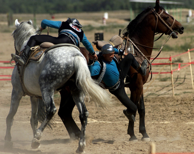 A test of strength is displayed in a game called Avderspak, two men on horseback lock hands and play tug-of-war in Almaty, Kazakhstan, on Sept. 13, 2000. Two Kazakh performer demonstrates this traditional game as part of the Gala concert by the Kazakh stars during the opening ceramonies of CENTRASBAT 2000 in Kazakhstan. The Gala Concert was a show by Kazakhstanis showing a variety of traditional dances and cultural events. CENTRASBAT is a multi-national peacekeeping and humanitarian relief exercise sponsored by U.S. Central Command (U.S. CENTCOM) and hosted by former Soviet Republic Kazakhstan in Central Asia, from Sept. 11-20. Exercise participants include approximately 300 U. S. troops,..