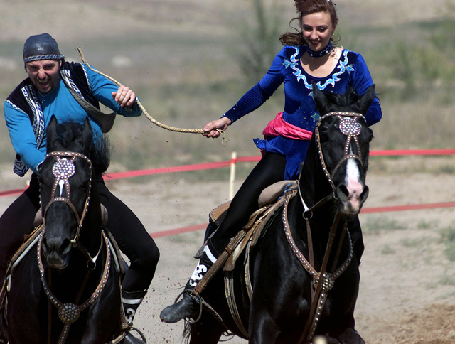 As part of the Gala concert of CENTRASBAT 00, Kazakh performers demonstrate a cultural tradition of a game called catch a girl, in which the two riders (male and female) take off on horseback and try and catch each other. The female rider whips the male until she is caught. If the male catches the female he is then rewarded with a kiss. The Gala concert was a show put on by Kazakhstanis, showing a variety of traditional dances and cultural events. CENTRASBAT is a multi-national peacekeeping and humanitarian relief exercise sponsored by US Central Command (US CENTCOM) and hosted by former Soviet Republic Kazakhstan in Central Asia, from Sept. 11-20. CENTRASBAT will test US and Central...