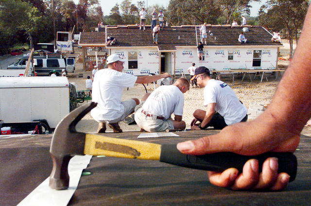 Several people including US Air Force members from MacDill Air Force Base, Florida, participated in the Habitat For Humanity Worldwide 1 Week- 10,000 Houses- Mission Possible Home Building Project