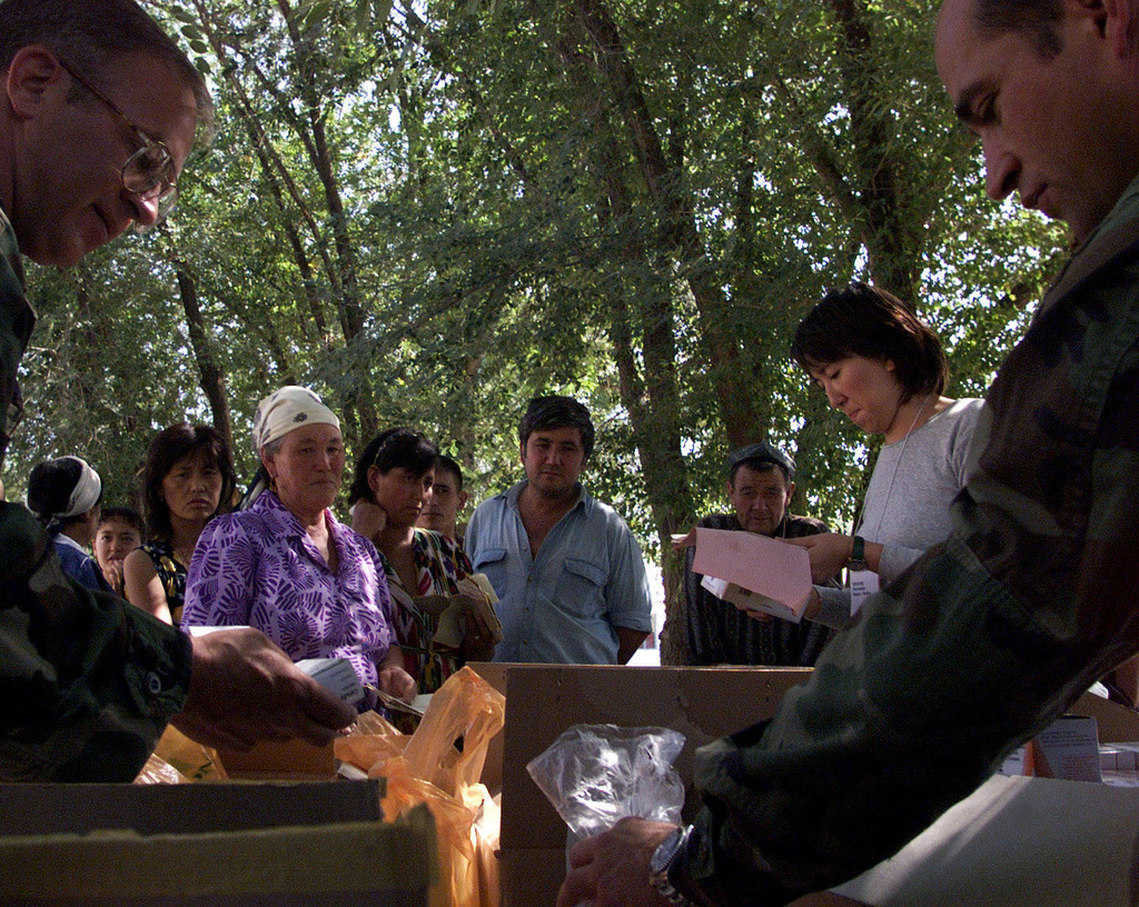 Members of the US Army 5th Special Forces Medical Unit, Fort Campbell, Kentucky, pass out medicine to local Kazakhs during Operation BALANCE KAYAK held in Kazakhstan (KAZ) 14 September 2000. BALANCE KAYAK,12-21 September 2000 is a medical capabilities exercise between US and Kazakhstan providing various facets of medical treatment to12 villages by screening patients and providing training to increase Kazakhstan's medical capabilities. Services offered are OBGYN, Orthopedics and General Practice with a fully equipped mobile pharmacy. All equipment used was provided by the host nation, Kazakhstan