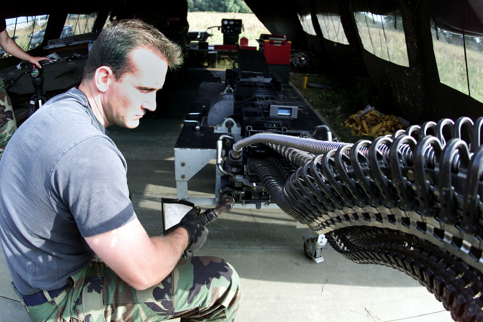 US Air Force Technical Sergeant Kenneth Childre, a Munnitions Systems Craftsman, 31st Maintenance Squadron, Aviano Air Base, Italy, finishes cycling a Universal Ammunition Loading system (UAL) so that it can be uploaded. Training Exercise IRON CLAW, Kuchyna AB, Slovakia (SVK), 14 September 2000