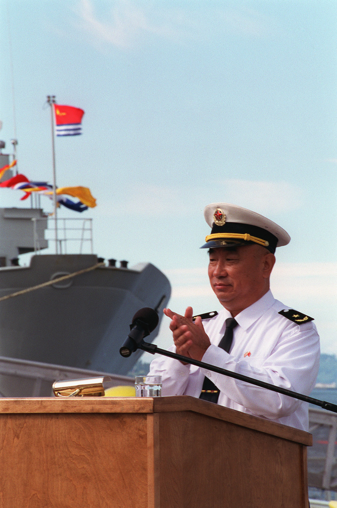 Chinese Peoples Liberation Navy Rear Admiral (RADM) Lu Fangqui, CHIEF of STAFF, North Sea Fleet, speaks during a Welcoming Ceremony at Naval Station Everett, Washington (WA)
