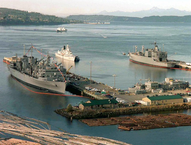 People's Liberation Army (Navy) destroyer QINGDAO (DDG 13) is tugged into port at Naval Station Everett flanked by the USS BRIDGE (AOE 10) and the USNS SHASTA (TAE 33) during the People's Republic of China Goodwill Cruise 2000