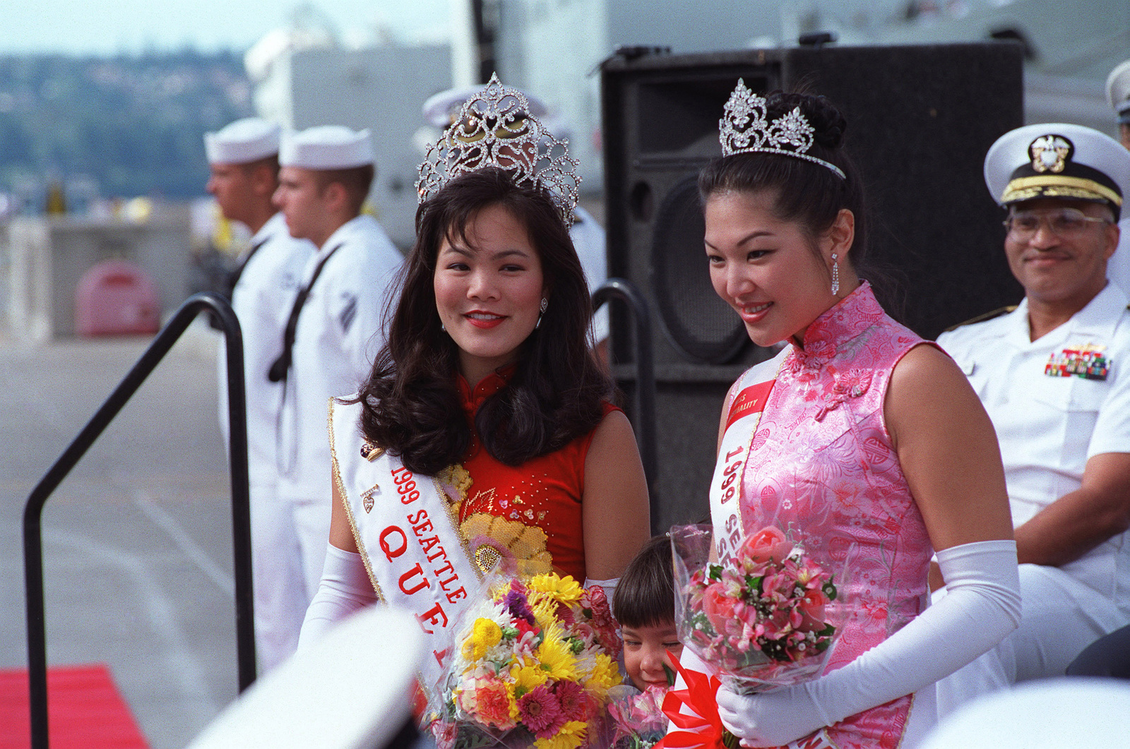 Representing the 1999 Miss Seattle Chinatown Pageant, this year's queen Jessica Chin (left) and princess Jennifer Chen, participate in the welcoming ceremony for the Chinese People's Liberation Army (Navy) visit to Naval Station Everett, Washington (WA)