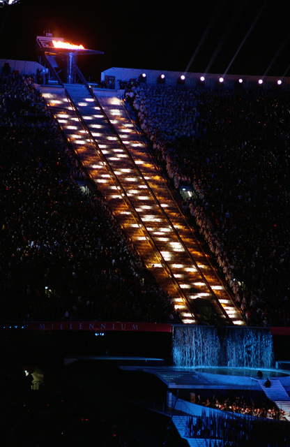 The Olympic torch is lit while raised to the top of the Olympic Stadium before an audience of 110,000 on September 15th, 2000, during the opening ceremonies for the Sydney 2000 Olympics