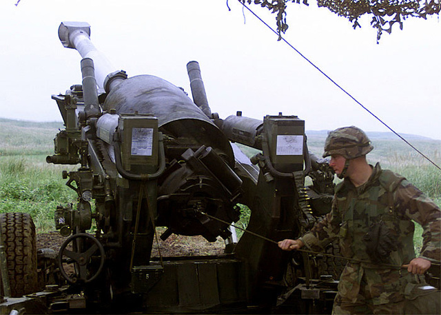 US Marine Corps Lance Corporal (LCPL), Karl Sherman, from 3D Marines 12th Battalion, pulls the landyard on the M198 155mm Howitzer and sends a round down range during Operation Fire Dragon at Camp Fuji, Japan. The goal of the operation is to enhance unit cohesion, improve speed of operation, and give Marines realistic combat training