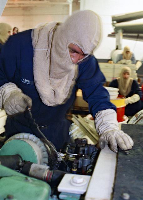 Aviation Support Equipment Technician Third Class (AS3) Rene Banda from El Paso, Texas, checks support equipment during a general quarters drill aboard USS ENTERPRISE (CVN 65)