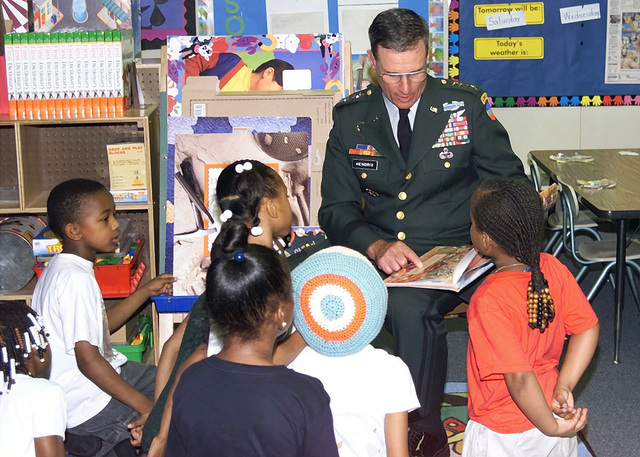 General John W. Hendrix, Commanding General Forces Command, reads to a second grade class at Dean Rusk Elementary School. Forces Command (FORSCOM) is in the Partners In Education program with Dean Rusk school. The program provides leadership in the formation and growth of effective partnerships that ensure success for all students