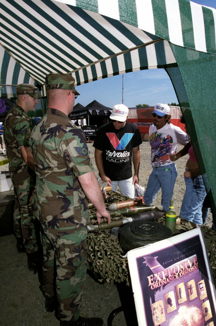 Members of the 436rd Explosive Ordinance Disposal Squadron, Dover Air Force Base, Delaware, answer questions concerning their daily duties and the explosives on show at Dover Downs International Speedway on September 23, 2000