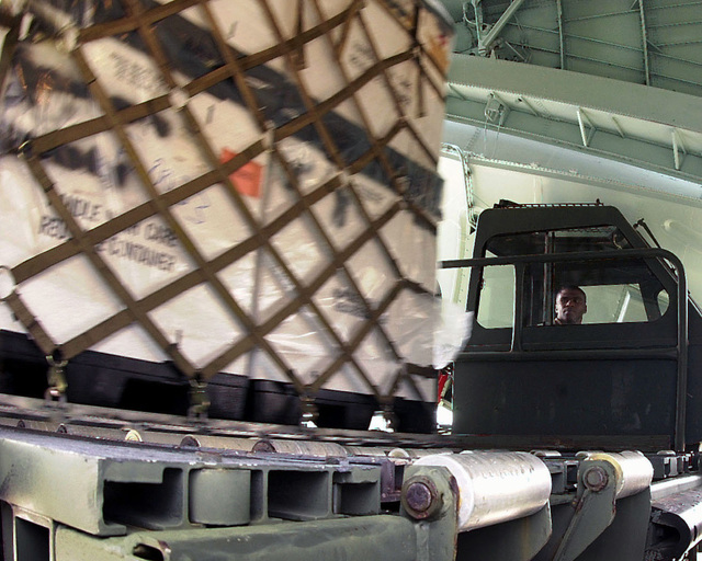 US Air Force Technical Sergeant Kenneth Holmes keeps an eye on the pallet his team is pushing onto a 25K loader. As part of Project Trans-Am, this US Air Force Reserve aerial port team moved $100,000 dollars worth of excess war reserve medical supplies onto a C-141C Starlifter aircraft from the 89th Airlift Squadron, Wright-Patterson Air Force Base, Ohio. The pallets of supplies were flown from Shaw Air Force Base, North Carolina, to Grissom Air Reserve Force, Indiana. Due to resizing, surplus medical supplies were donated to native North American-Indian communities. They will identify what they need from an inventory list. Then the supplies from the pallets will be repackaged and ...