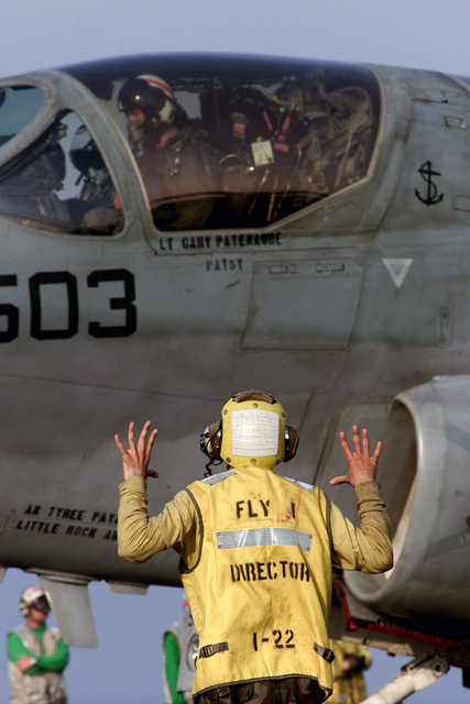 Aviation Boatswains Mate Third Class (ABH3) Edgar Centeno signals the pilot of a EA-6B Prowler, from the Electronic Attack Squadron One Two Three Two (VAQ 132) Scorpions, prior to launching from the fight deck of the aircraft carrier USS GEORGE WASHINTON (CVN 73), in support of Operation SOUTHERN WATCH 2000