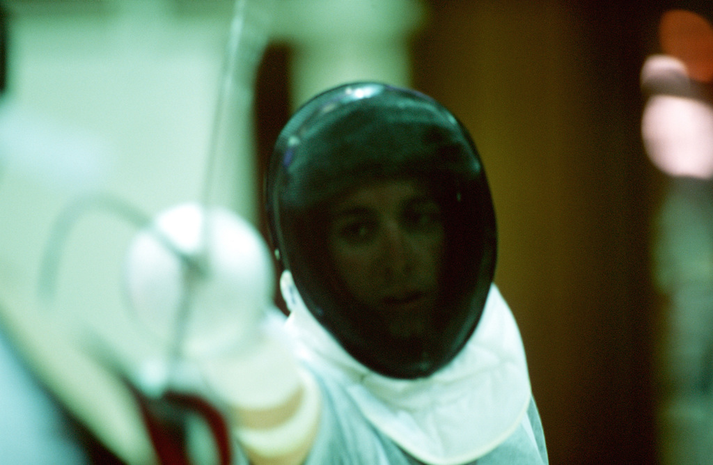 Straight on, close-up shot of US Army SPECIALIST Chad SENIOR in his Fencing attire. SPC SENIOR, a member of the US Army's World Class Athlete program, works out in a local Sydney, Australia, youth gymnasium in preparation for the Modern Pentathlon, on September 30th, 2000 during the Olympic games