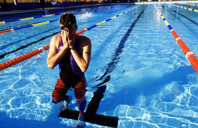 Straight on, medium shot as US Army SPECIALIST Chad SENIOR as he takes a break form his workout in the pool in Sydney, Australia in preparation for the Modern Pentathlon, on September 30th, 2000 during the Sydney Olympic games. SPC SENIOR is from the US Army's World Class Athlete Program