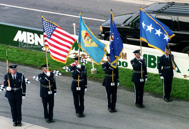 Dover Air Force Base Honor Guard presents colors before the start of the MBNA 400 held at Dover Downs International Speedway, Delaware, on September 24, 2000