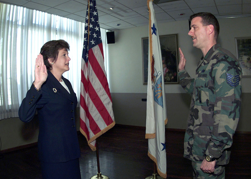 The Honorable Carol DiBattiste, Under Secretary of the Air Force re-enlists US Air Force Technical Sergeant Tate Leger, 31st Maintenance Squadron, Aviano Air Base, Italy. Ms DiBattiste stopped at Aviano Air Base to meet with troops and families and talk about recruiting and retention