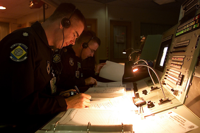 US Air Force Lieutenant Colonel Joe Hogler and USAF Captain Craig Blackwell, 30th Range Squadron, Vandenberg Air Force Base, California, prepare to countdown for the launch of a Minuteman III missile. The missile was launched for a force development mission that let Space Command verify the weapons system