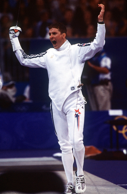 Straight on, medium close-up shot of US Army SPECIALIST Chad SENIOR as he celebrates a win over an opponent (Not shown) at the fencing venue during the Modern Pentathlon at the Olympic Park in Sydney on Saturday September 30th, 2000. SPC SENIOR comes to the 2000 Sydney Olympic games by way of the US Army's World Class Athlete Program