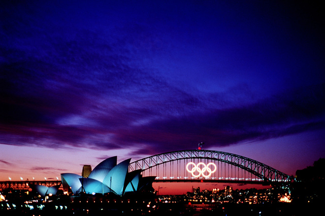 The last sunset over the Sydney Harbour Bridge before closing ceremonies of the Olympics games in Sydney, Australia. Fifteen US Department of Defense personnel participated in the Olympics, from coaches and support staff to athletes competing in various venues