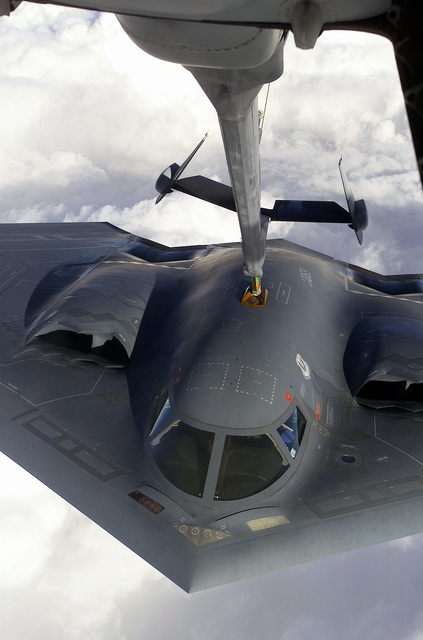 "A B-2 Spirit aircraft from Whiteman Air Force Base, Missouri, makes contact with the boom of a McGuire Air Force Base, New Jersey, KC-10A Extender aircraft during a Capstone orientation flight. Capstone is a Joint Airborne/Air Transportability Training mission providing interservice training for the wartime application of airlift. Through Capstone, senior level officers are able to observe the significance of airlift and its role in all military operations. The B-2 Spirit is a multi-role bomber capable of delivering both conventional and nuclear munitions. Its low-observable, or ""stealth,"" characteristics give it the unique ability to penetrate an enemy's most sophisticated defenses and ..."