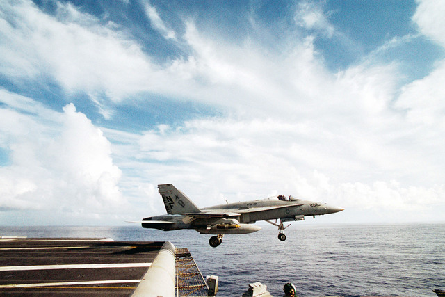 """An F/A-18 """"Hornet"""" attached to the """"Royal Maces"""" of Strike Fighter Squadron Two Seven (VFA-27) launches off the deck of the USS KITTY HAWK (CV 63)"""