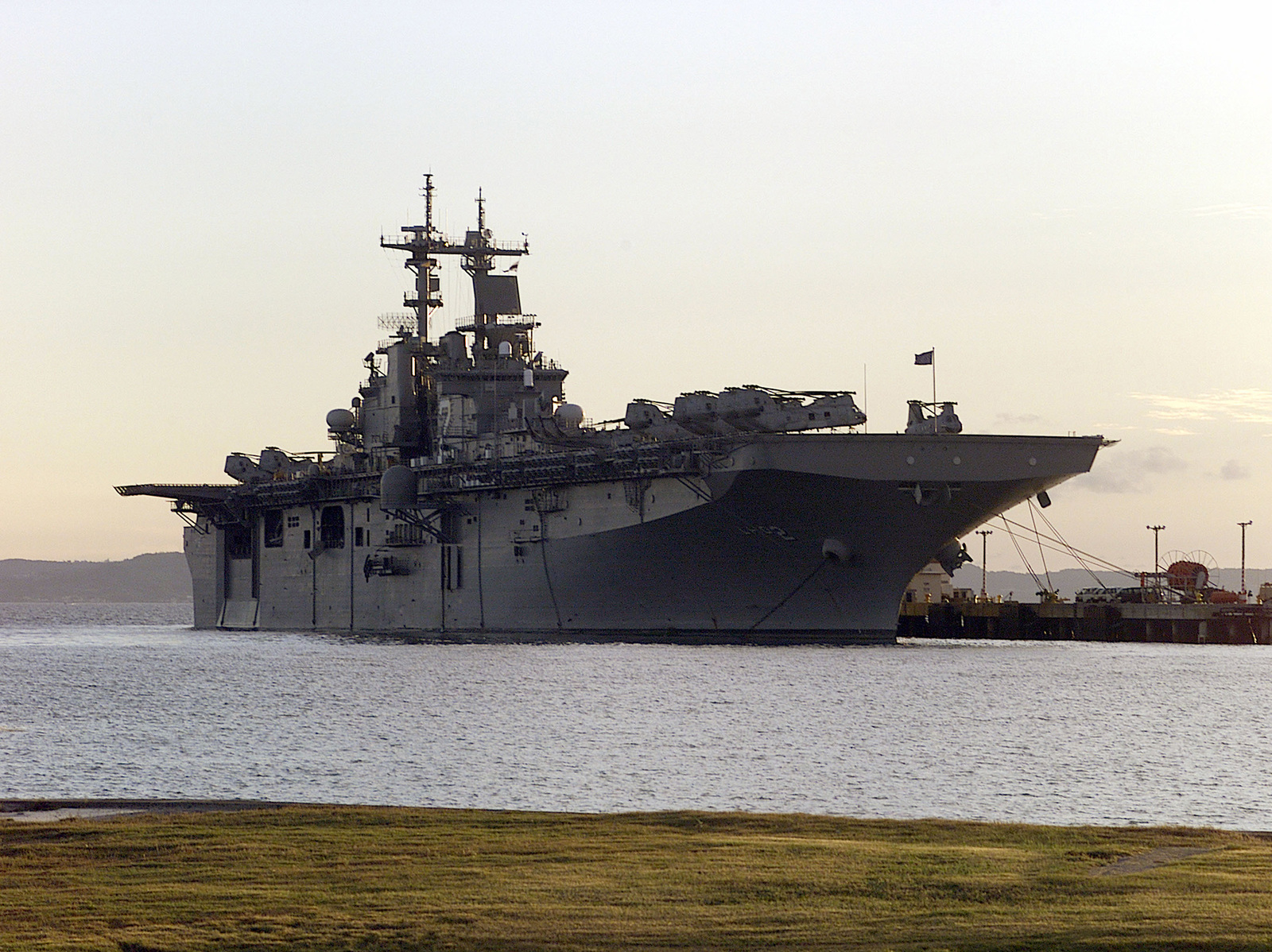 The USS Essex (LHD 2) sits docked at the White Beach port in Okinawa, Japan. While its crew gets some well-deserved liberty time after being on board for two weeks for the Amphibious Ready Group Exercise (ARGEX) and Special Operations Capable Exercise (SOCEX). The US Marines from the 31st Marine Expeditionary Unit spent two months participating in various training operations on and off the coast of Okinawa, Japan, Sasebo, Japan, Pohang, Korea, and Hong Kong, China