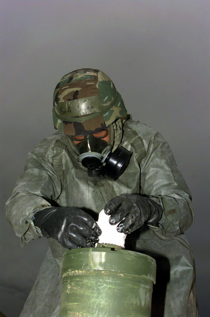 A US Air Force AIRMAN is secures an oozing UXO during a simulated air attack during an exercise taking place at Luke Air Force Base, Arizona