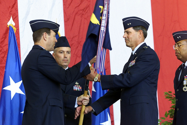 US Air Force General Charles T. Robertson (left), Commander of the Air Mobility Command, passes the 21st Air Force flag to USAF Major General George N. Williams, at the 21st Air Force Change of Command Ceremony. Command of the 21st Air Force passed from MGEN John D. Hopper, Jr. (far right) to MGEN George N. Williams. GEN Charles T. Robertson, Commander of the Air Mobility Command acted as the presiding official for the ceremony. Headquarters, 21st Air Force is responsible for assessing operational readiness and recommending improvements in the tanker/airlift system within the 21st Air Force area of Africa, Southwest Asia, Europe, the Caribbean, South and Central America, the Eastern ...