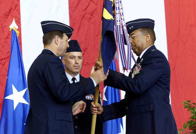 US Air Force Major General John D. Hopper, Jr. (right) passes the 21st Air Force flag to USAF General Charles T. Robertson, Commander of the Air Mobility Command, at the 21st Air Force Change of Command Ceremony. Command of the 21st Air Force passed from MGEN John D. Hopper, Jr. to MGEN George N. Williams (not shown). GEN Charles T. Robertson, Commander of the Air Mobility Command acted as the presiding official for the ceremony. Headquarters, 21st Air Force is responsible for assessing operational readiness and recommending improvements in the tanker/airlift system within the 21st Air Force area of Africa, Southwest Asia, Europe, the Caribbean, South and Central America, the Eastern ...
