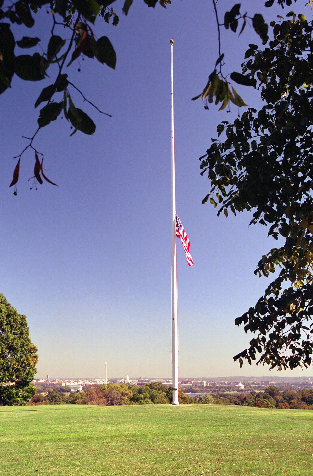 At Whipple Field, Fort Myer, the Flag of the United States is flown at half-mast at the direction of the President in memory of those service members killed onboard the USS COLE