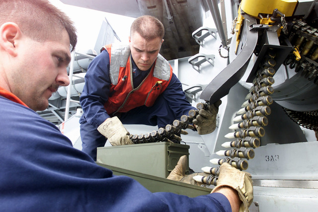 Fire Controlman 1ST Class (FC1) Howard Forsythe from Mikado, Michigan, loads live ammunition as FC3 Christopher McCoy from Pocatello, Indiana, downloads dummy rounds from an MK-15 Close In Weapon System (CIWS), aboard the USS HARRY S. TRUMAN (CVN 75)