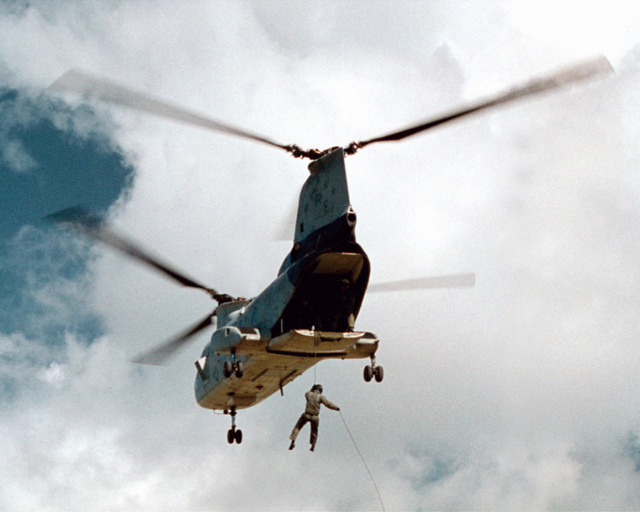 """Sailors attached to Explosive Ordnance Disposal Mobile Unit Five (EODMU5) repel from a CH-46E """"Sea Knight"""" helicopter attached to the """"Providers"""" of Helicopter Combat Support Squadron Five (HC-5) over Orote Point, Santa Rita, Guam"""