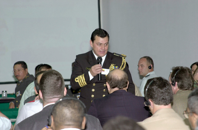 "An unidentified Colombian Navy Captain answers questions during the initial planning conference for ""Peacekeeping Operations South 2001"". The two-day conference is being held in Quito, Ecuador. Military and civilians members from Argentina, Bolivia, Brazil, Chile, Colombia, Paraguay, Peru, Uruguay, and Venezuela participated in the US and Ecuadorian hosted event"