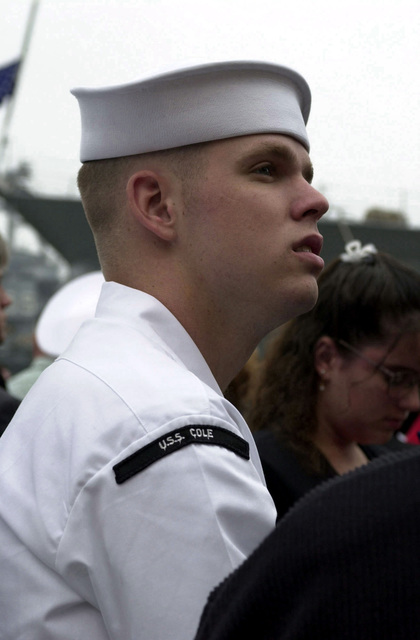 Gas Turbine Systems (GS) Nicholas Burnworth, a survivor of the terrorist attack on the USS COLE (DDG-67), attends the memorial service for his deceased, missing and surviving shipmates