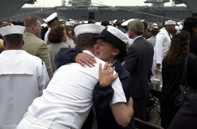 Injured USS COLE (DDG 67) survivor SEAMAN Recruit (SNR) Kesha Stidham hugs a shipmate during the memorial service held on Pier 12 at Naval Station Norfolk, Virginia