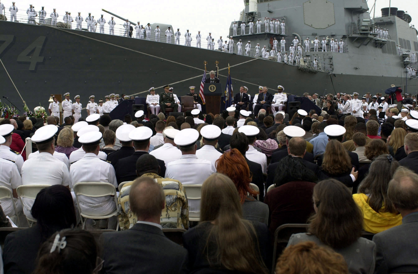 President Clinton (Commander in CHIEF) and other military leaders address a closed memorial service for families and friends of the sailors killed and those still missing as a result of the terrorist attack on the USS COLE (DDG 67) in the port of Aden, Yemen