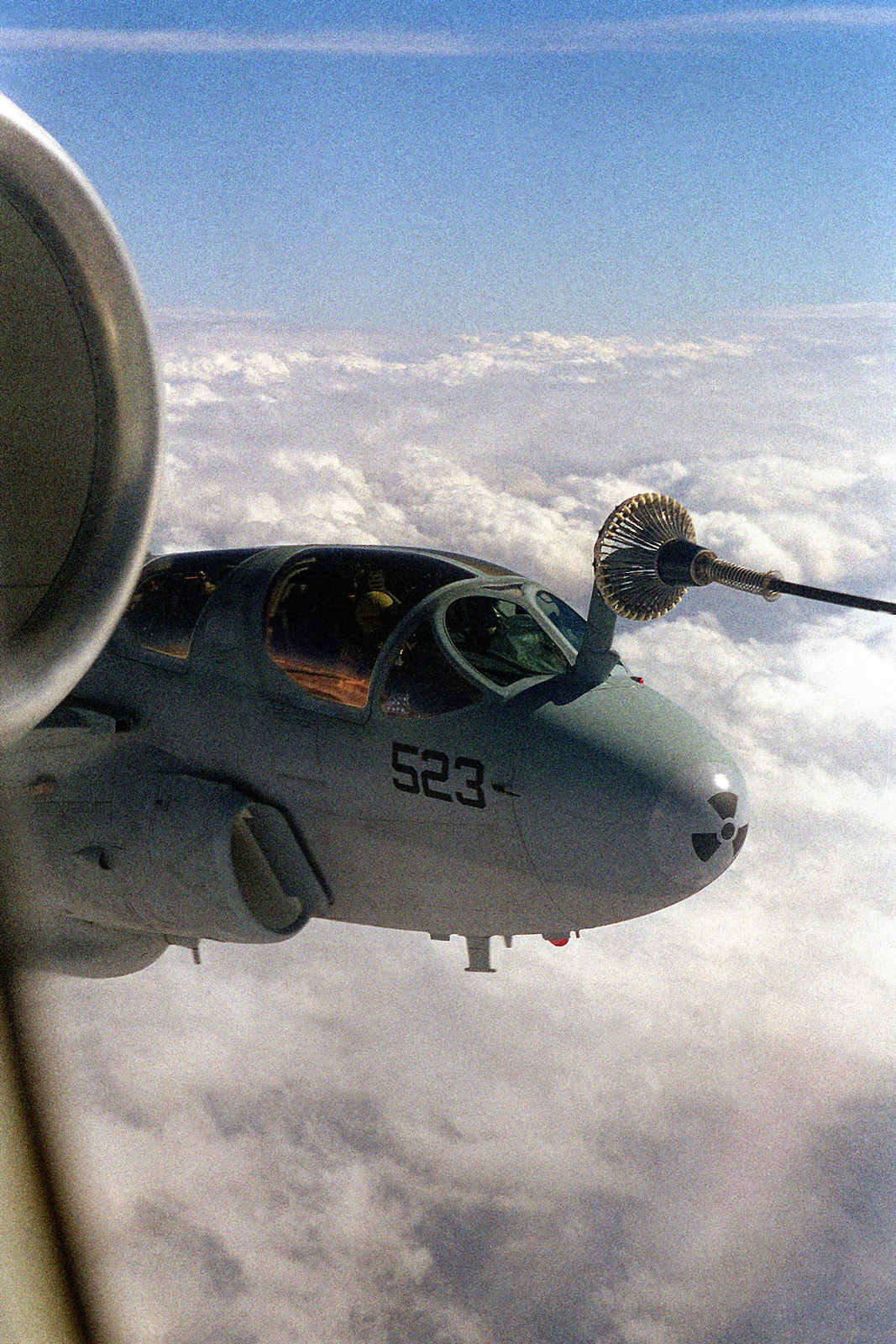 """US Navy A-6E """"Intruder"""" preforms an air refueling from a British Royal Air Force VC-10 Tanker Refueler (Partially seen at left). The aircraft are deployed to the region in support of Operation NORTHERN WATCH"""